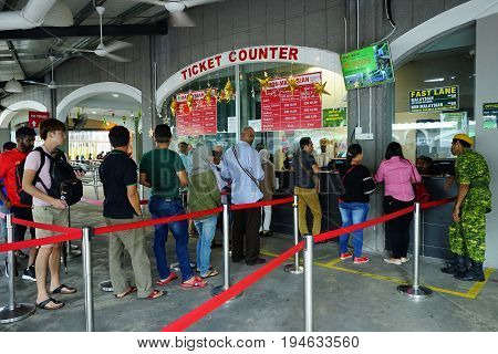 PENANG MALAYSIA - JUNE 292017 : Tourist queueing to buy tickets at counters in Penang Hill Malaysia. A famous tourism place among locals and foreign tourist.