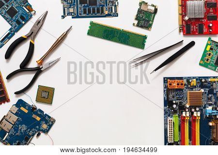 Computer repair and upgrade background, copy space. Motherboard top view, flat lay. Technology maintenance, electronics repair shop concept