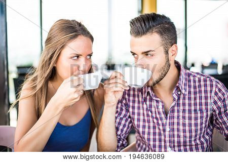 Couple doing breakfast in a bar coffeehouse - Lovers at a romantic date