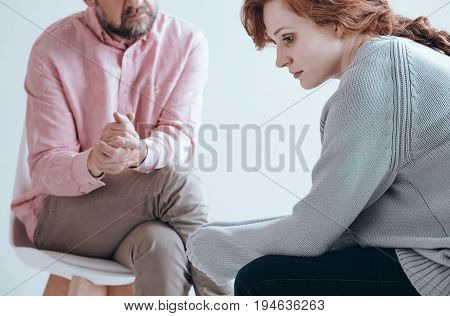Apathetic girl having an individual therapy with counselor