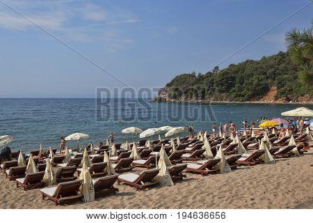 The Sand And Pebble Beach Of Mogren In Budva
