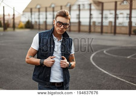 Handsome Man With Vintage Glasses Wearing A White Shirt And Denim Waistcoat