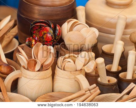 Wooden kitchen utensils: cups and spoons. Kitchen Decor.