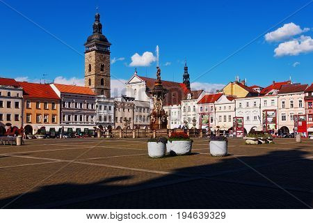 CESKE BUDEJOVICE CZECH REPUBLIC - JULY 05 2016: Central town square with Samson fighting the lion fountain sculpture and bell tower