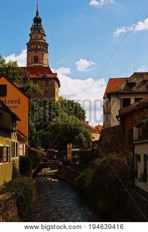 CESKY KRUMLOV CZECH REPUBLIC - JULY 06 2016: Castle tower stands over the Vltava confluent