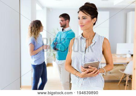 Beautiful Young Businesswoman Looking Sideways In Modern Office.