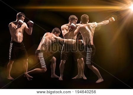 Male Athlete boxer punching a punching bag with dramatic edgy lighting in a dark studio. Image made with stroboscope