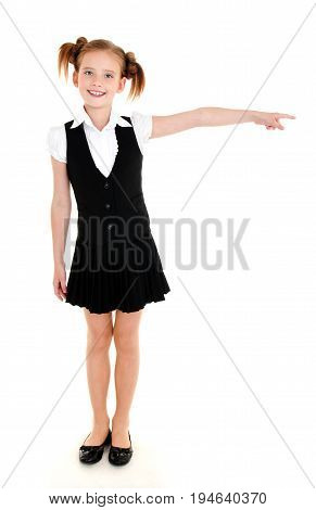 Smiling happy school girl child in uniform showing to the right left isolated on a white background