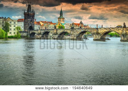 Colorful sunset and spectacular cityscape with old stone Charles bridge in Prague Czech Republik Europe
