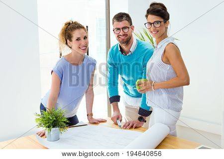 Group Of Business People Looking At Camera In Modern Office.