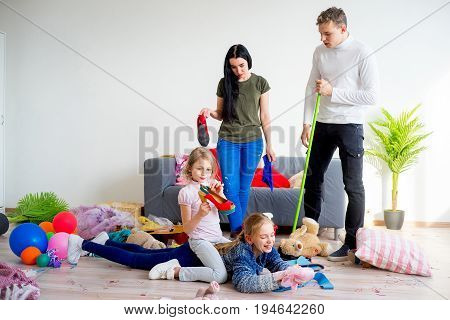 Parents cleaning mess up after their daughters