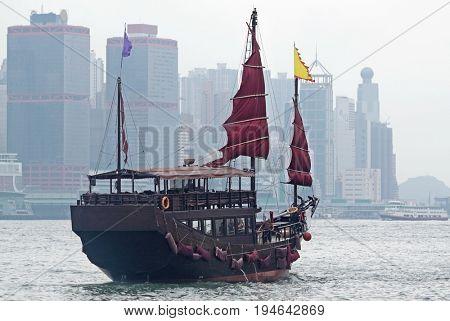 sailboat in Hong Kong harbor at day
