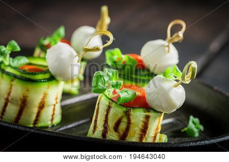 Various Finger Food Made Of Fresh Ingredients On Burnt Table