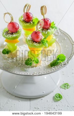 Closeup Of Finger Food With Fruits And Mint For Party