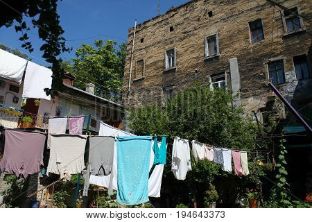 Old courtyard with clothes on clothesline in Odessa.