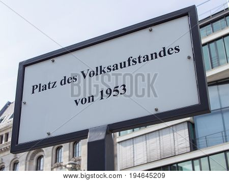 BERLIN GERMANY - JULY 9 2017: Street Sign Platz des Volksaufstandes von 1953 Meaning Place of The Popular Uprising of 1953 In German Language Berlin