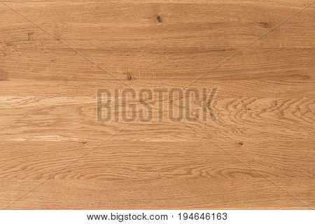 Close-up of wooden board of natural shade of light brown color with expressive texture. Ligneous background with copy space