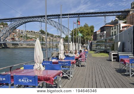 GAIA, PORTUGAL - AUGUST 7, 2015: People at outdoors restaurant in the promenade of Gaia located south of the city of Porto on the other side of the Douro River Portugal.
