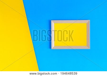 Photo wood frame on colorful paper wall background With memories and nobody