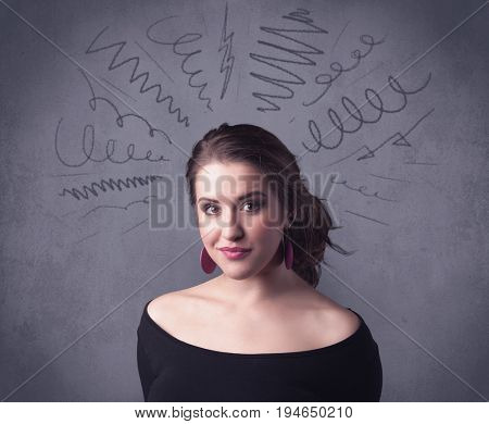 A cute female student making funny face expressions with pressure and problems in her head illustrated by drawn lines, marks and spirals on the urban wall background concept.