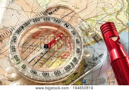Compass on Map and Red Rescue Whistle