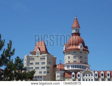 Modern castle-type building over the blue sky photo