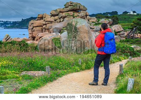 Active young sportive hiker woman in nature Perros Guirec Brittany region France Europe