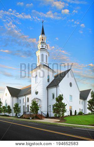 White Christian Catholic Baptist Church at Sunrise with tower and cross, Religion, God, Steeple