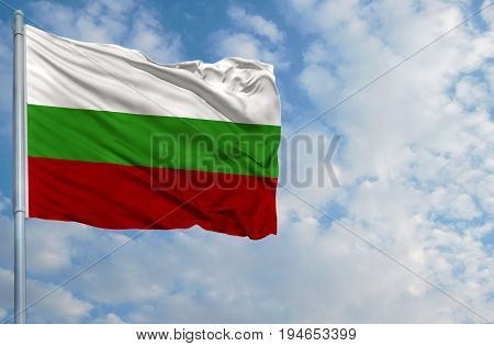 National flag of Bulgaria on a flagpole in front of blue sky