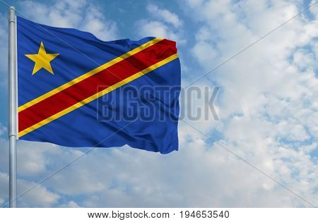 National flag of Congo Democratic on a flagpole in front of blue sky.