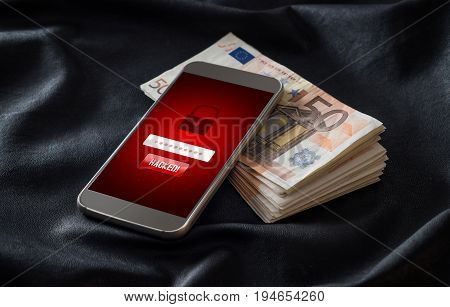 Hacked. Cyber security and mobile hacking concept. Smartphone and stack of money and 50 euro bills. Online criminal login to personal information and data.