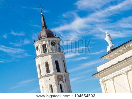 Close up of the top of belfry and bell tower of the Cathedral of Vilnius, Lithuania. Party cloudy sky on a summer day.