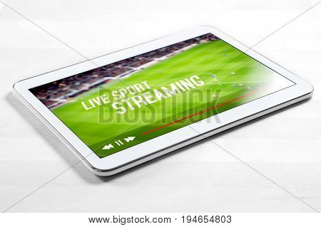 Live sport stream online with mobile device. White tablet on wooden table with imaginary video player and streaming service.