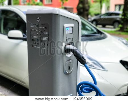 Electric car charging station in Oslo. Eco automobile that sparked a revolution