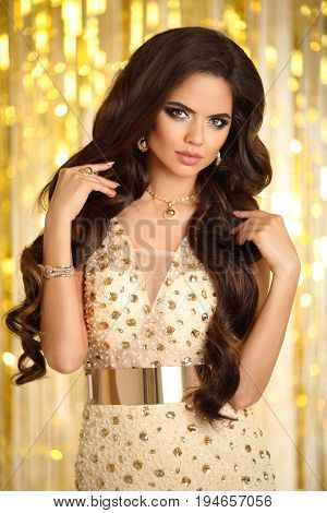 Hair. Elegant Brunette Woman. Fashion Jewelry. Wavy Hairstyle. Sexy Glamour Model Lady In Golden Dre