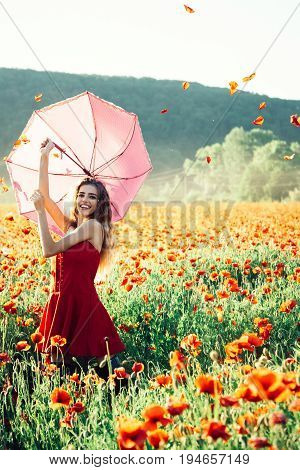 Umbrella Pink Color At Girl In Field Of Red Poppy