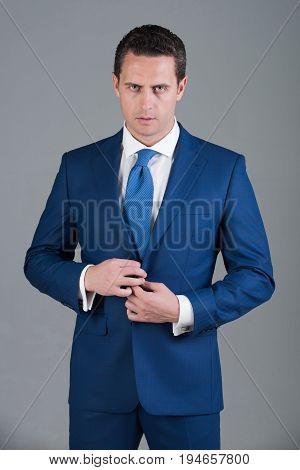Handsome Man Buttoning Button On Elegant Blue Formal Suit Jacket