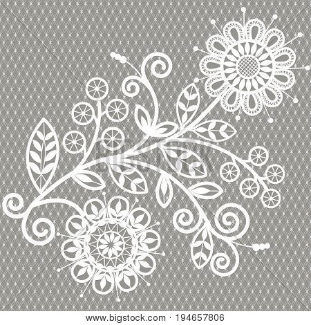 White lace pattern with floral elements on a gray background