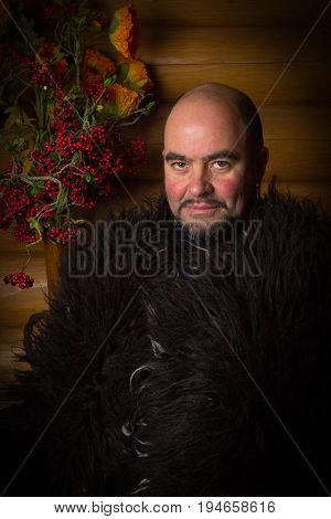 Warrior, Bald Man With A Beard And Mustache In A Black Fur Coat