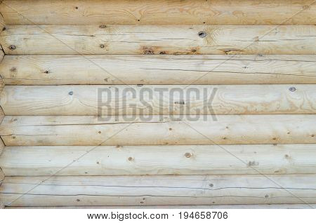 The wall of wooden house log house from logs
