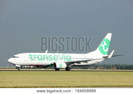 Amsterdam the Netherlands - July 6th 2017: PH-HZE Transavia Boeing 737-800 takeoff from Polderbaan runway Amsterdam Schiphol Airport