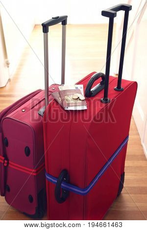 Two suitcases standing in hallway elevated view
