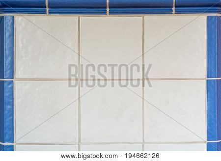 White Tiles From A Tiled Stove Framed With Blue Tiles