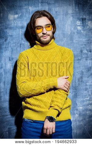 Handsome man wearing yellow pullover and sunglasses. Men's beauty, fashion. Hairstyle for men.