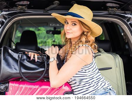 Summer vacation car road trip freedom concept. Happy woman cheering joyful during holiday travel with car