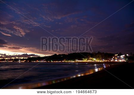 Beautiful Night View Of The Illuminated Unawatuna Tropical Beach On The Background Of Colorful Twili