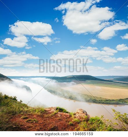 Inspiring image of the sinuous river flowing through hills. Picturesque and gorgeous morning scene. Location place Dnister canyon, Ukraine, Europe. Drone photography. Explore the world's beauty.