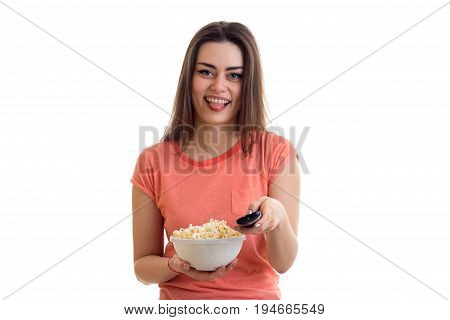 funny young woman watching tv with pop-corn isolated on white background