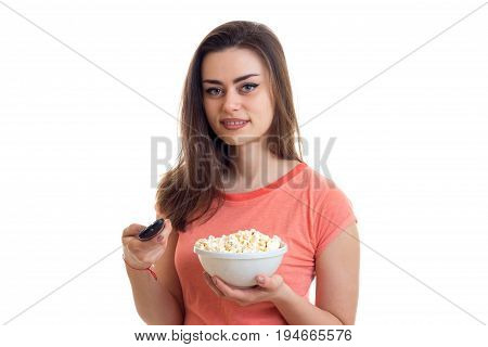cute young woman watching tv with pop-corn isolated on white background