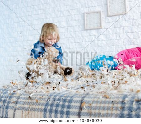 Happy cute girl with her toy animals, bedtime, childhood and family concept